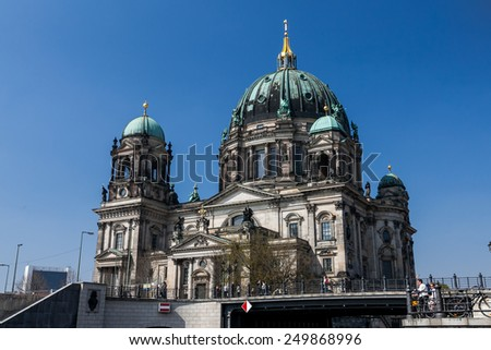 BERLIN, GERMANY - APRIL 12: Berlin Cathedral (German: Berliner Dom) located on Museum Island in the Mitte borough in Berlin on April 12, 2009. The current building was finished in 1905. - stock photo