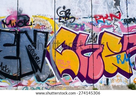 BERLIN, GERMANY - 30 April 2015: East Side Gallery, Friedrichshain, Berlin. Graffiti on the Berlin Wall. Berlin on April 30, 2015. Berlin, Germany - stock photo