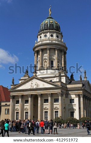 BERLIN, GERMANY, APRIL 22, 2016: French Cathedral on Gendarmenmarkt. Gendarmenmarkt is considered the most beautiful square in Berlin.