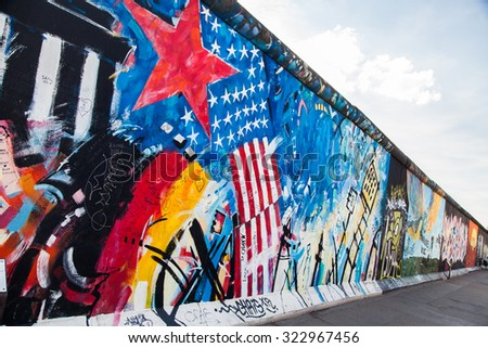 BERLIN, GERMANY - AUGUST 6 2015: Berlin Wall graffiti. The East Side Gallery is an international memorial for freedom. It is a 1.3 km long section of the Berlin Wall located near the centre of Berlin - stock photo