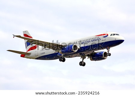 BERLIN, GERMANY - AUGUST 17, 2014: British Airways Airbus A320 arrives to the Tegel International Airport. - stock photo