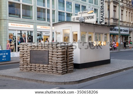 Berlin, Germany - August 7, 2015: Checkpoint Charlie in Berlin, Germany. It was the former border crossing between the West and East Berlin during the Cold War. - stock photo