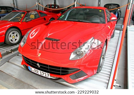 BERLIN, GERMANY - AUGUST 12, 2014: Italian supercar Ferrari F12 Berlinetta in the museum of vintage cars Classic Remise. - stock photo