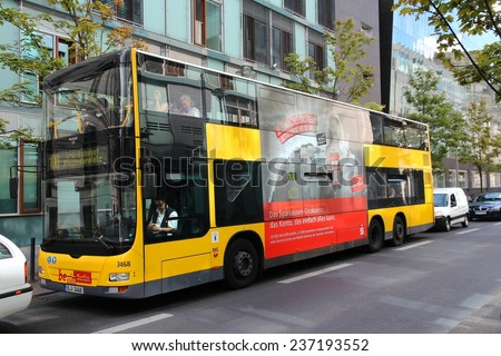 BERLIN, GERMANY - AUGUST 27, 2014: People ride a Man city bus in Berlin. Public transport company BVG operates 149 daytime bus routes with 2634 stops. - stock photo