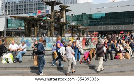 BERLIN, GERMANY - AUGUST 26, 2014: People visit famous Alexander Square (Alexanderplatz) in Berlin. Berlin is Germany's largest city with population of 3.5 million.