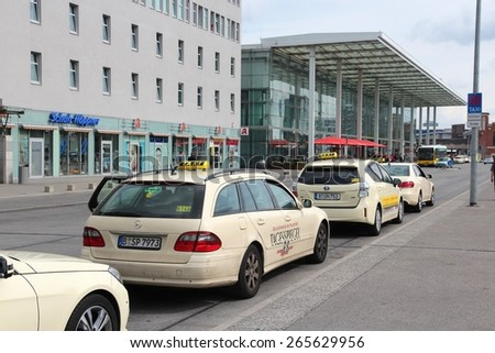 BERLIN, GERMANY - AUGUST 26, 2014: Taxi drivers wait at Ostbahnhof railway station in Berlin. There are some 7,500 taxis in Berlin.