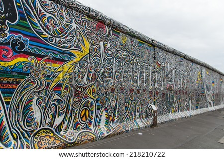 """Berlin, Germany - Augustus 30  2014: Part of the """"East Side Gallery"""".  It's a 1.3 km long part of original Berlin Wall which collapsed in 1989 and now is the largest world graffiti gallery - stock photo"""
