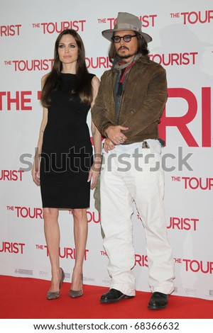 BERLIN, GERMANY - DECEMBER 14: Angelina Jolie and Johnny Depp attend the Photocall of 'The Tourist' at the Hotel Adlon. December 14, 2010 in Berlin, Germany. - stock photo