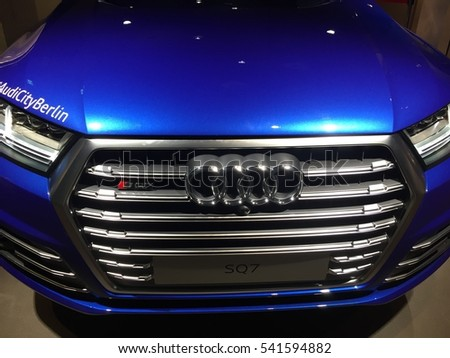 Berlin, Germany - December 18, 2016: Audi company emblem on blue car. Audi AG is a premium German automobile manufacturer that designs, engineers, produces markets and distributes luxury automobiles