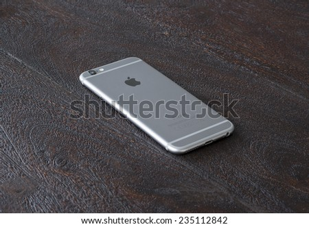 BERLIN, GERMANY - DECEMBER 3: backside of an new space gray iPhone 6 from Apple on wooden surface, Dec 3 2014 in Berlin - stock photo
