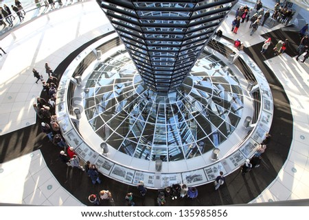 BERLIN, GERMANY-DECEMBER, 7: The Reichstag dome is a glass dome constructed on top of the rebuilt Reichstag building in Berlin, symbolize the reunification of Germany on December 7, 2012 in Berlin.