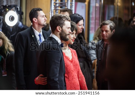 BERLIN, GERMANY - FEBRUARY 11, 2015: Actor Jamie Dornan and wife Amelia Warner attend the 'Fifty Shades of Grey' premiere during the 65th Berlinale International Film Festival at Zoo Palast  - stock photo