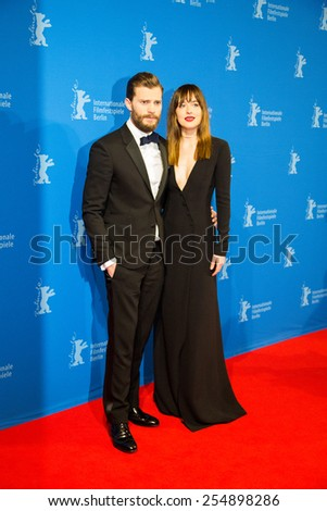 BERLIN, GERMANY - FEBRUARY 11: Actress Dakota Johnson, Jamie Dornan, 'Fifty Shades of Grey' premiere, 65th Berlinale International Film Festival at Zoo Palast on February 11, 2015 in Berlin, Germany.  - stock photo