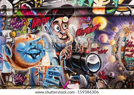 BERLIN, GERMANY - FEBRUARY 5, 2013:  Anonymous graffiti image shows a crazed photographer snapping images as seen on an alley wall in Berlin on February 4, 2013.