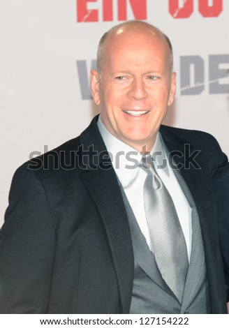 """BERLIN - GERMANY - FEBRUARY 4: Bruce Willis at the """"A Good Day to Die Hard"""" premiere at CineStar, Sony Center, Potsdamer Platz on February 4, 2013 in Berlin, Germany. - stock photo"""