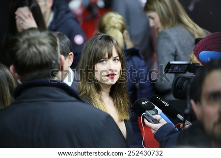 BERLIN, GERMANY - FEBRUARY 11: Dakota Johnson attends the 'Fifty Shades of Grey' premiere during the 65th Berlinale Film Festival at Zoo Palast on February 11, 2015 in Berlin, Germany. - stock photo