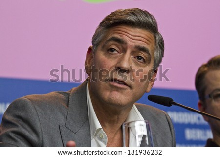 BERLIN, GERMANY - FEBRUARY 08: George Clooney attends 'The Monuments Men' press conference during 64th Berlinale Film Festival at Grand Hyatt Hotel on February 8, 2014 in Berlin, Germany. - stock photo