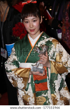 BERLIN, GERMANY - FEBRUARY 15: Haru Kuroki poses with his Silver Bear for Best  Actress after the closing ceremony during Berlinale Festival at Palast on February 15, 2014 in Berlin, Germany.  - stock photo