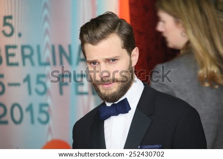 BERLIN, GERMANY - FEBRUARY 11: Jamie Dornan attends the 'Fifty Shades of Grey' premiere during the 65th Berlinale Film Festival at Zoo Palast on February 11, 2015 in Berlin, Germany. - stock photo
