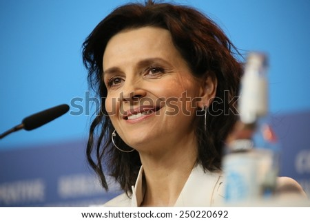 BERLIN, GERMANY - FEBRUARY 5: Juliette Binoche poses during the  press conference for the 'Nadie quiere la noche'  presented at the 65th Film Festival in Berlin, on February 5, 2015. - stock photo