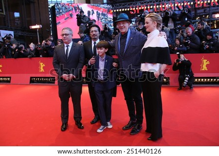 BERLIN, GERMANY - FEBRUARY 08: Milo Parker,  Laura Linney, Ian McKellen attend the 'Mr. Holmes' premiere during the 65th Film Festival at Berlinale Palace on February 8, 2015 in Berlin, Germany. - stock photo