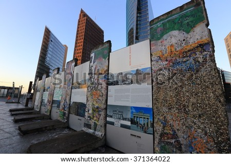 BERLIN, GERMANY - January 09 2016: Segments of the wall in central East Berlin, Potsdamer platz. - stock photo
