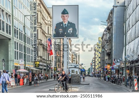 BERLIN, GERMANY - July 26,2008 CHECKPOINT CHARLIE Streetview  Checkpoint Charlie is the most famous crossing point between East and West Germany during the cold war. - stock photo