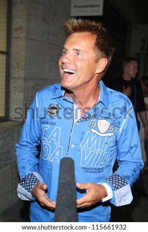 BERLIN, GERMANY - JULY 05: Dieter Bohlen attends the Camp David show during Mercedes-Benz Fashion Week Spring/Summer 2013 at Olympia Stadium on July 5, 2012 in Berlin, Germany. - stock photo