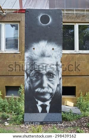 BERLIN, GERMANY - JULY 07: Segment of Berlin Wall in East Berlin with Albert Einstein portrait painted on. July 07, 2015 in Berlin. - stock photo