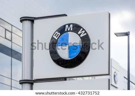 "BERLIN, GERMANY - July 23: the logo of the brand ""BMW"" at a car dealer building on Jul 23 2015 in Berlin, Germany, Europe, BMW is a German automobile, motorcycle and engine manufacturing company."