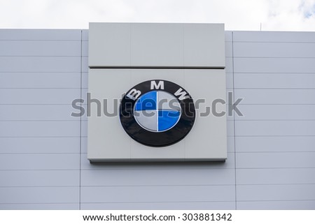"BERLIN, GERMANY - July 23: the logo of the brand ""BMW"" at a new car dealer building on Jul 23 2015 in Berlin, Germany, Europe, BMW is a German automobile, motorcycle and engine manufacturing company. - stock photo"