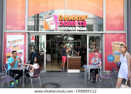 BERLIN, GERMANY - JUNE 11, 2014: A general view of a Dunkin' Donuts coffee shop in  Berlin, Germany, on Saturday, June 11, 2014 - stock photo