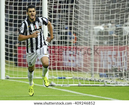 BERLIN, GERMANY - JUNE 8, 2015: Alvaro Morata of Juventus celebrates after he scored an equalizer goal during the 2015 UEFA Champions League Final against FC Barcelona. Spanish side won, 3-1. - stock photo