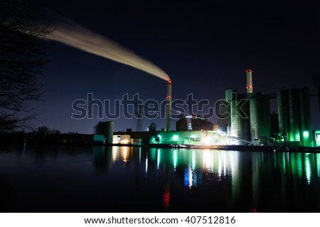 BERLIN, GERMANY - JUNE 03, 2013: Vattenfall Power plant on the river shore of the Spree at night in Berlin