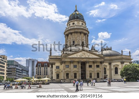 BERLIN, GERMANY - JUNE 16, 2014: View of Gendarmenmarkt square in Berlin and site of Konzerthaus, French and German Cathedrals. Square was created by Johann Arnold Nering at end of seventeenth century