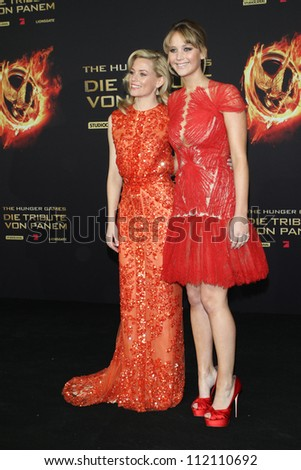 BERLIN, GERMANY - MARCH 16: Elizabeth Banks and Jennifer Lawrence attend the Germany premiere of 'The Hunger Games' at Cinestar on March 16, 2012 in Berlin - stock photo