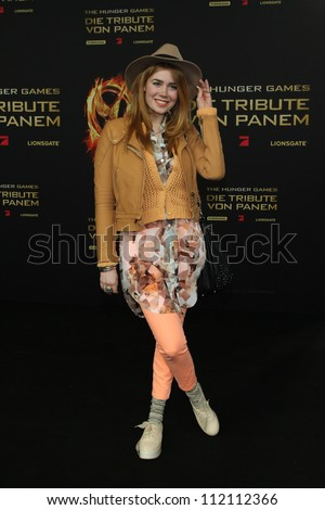 BERLIN, GERMANY - MARCH 16: Palina Rojinski attends the Germany premiere of 'The Hunger Games' at Cinestar on March 16, 2012 in Berlin - stock photo