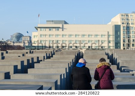 BERLIN, GERMANY, MARCH 12, 2015: people are admiring concrete blocks of the jewish holocaust memorial in berlin - memorial to the murdered jews of europe. - stock photo