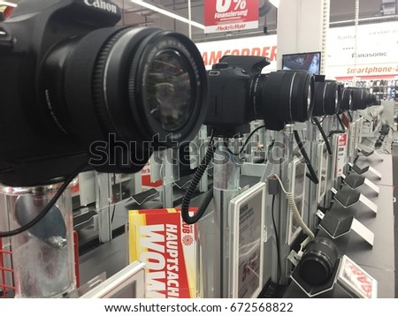Berlin, Germany - May 6, 2017: Canon cameras in MediaMarkt store. That is a Japanese multinational corporation manufacturing imaging and optical products, including cameras, and computer printers