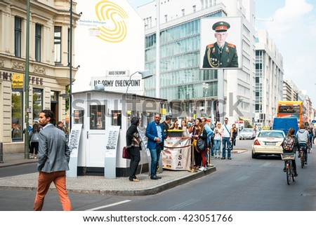BERLIN, GERMANY- May 18: Checkpoint Charlie. Former bordercross in Berlin on May 18, 2016. Berlin Wall crossing point between East and West Berlin during the Cold War. BERLIN, GERMANY - stock photo