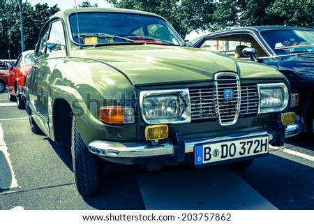 BERLIN, GERMANY - MAY 17, 2014: Compact car Saab 96. Toning. Imitation cross-process. 27th Oldtimer Day Berlin - Brandenburg  - stock photo