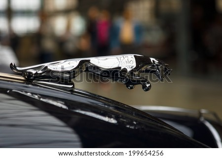 BERLIN, GERMANY - MAY 17, 2014: Hood ornament (Jaguar in the jump) of the sports car Jaguar XK150 S Coupe. 27th Oldtimer Day Berlin - Brandenburg  - stock photo