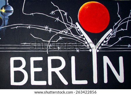 BERLIN GERMANY MAY 22: Mural by Gerhard Lahr: Berlyn on may 22 2010 in Berlin Germany. East Side Gallery - the largest outdoor art gallery in the world. - stock photo