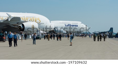 BERLIN, GERMANY - MAY 22, 2014: Passenger jet aircraft Boeing 747-8, Lufthansa and Airbus A380, Emirates Airlines on the airfield. Exhibition ILA Berlin Air Show 2014 - stock photo