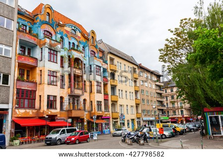 Berlin, Germany - May 17, 2016: street view in the Berlin district Kreuzberg. Kreuzberg has emerged from one of the poorest quarters to one of Berlins cultural centers - stock photo