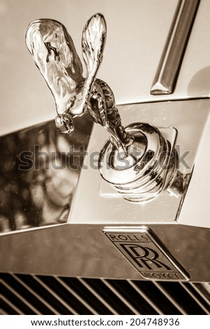 "BERLIN, GERMANY - MAY 17, 2014: The famous emblem ""Spirit of Ecstasy"" on the Rolls-Royce Silver Spirit. Sepia. 27th Oldtimer Day Berlin - Brandenburg - stock photo"