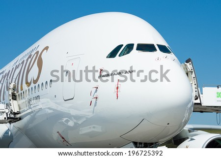 BERLIN, GERMANY - MAY 22, 2014: The largest passenger airliner in the world Airbus A380. Emirates Airline. Exhibition ILA Berlin Air Show 2014 - stock photo