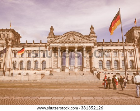 BERLIN, GERMANY - MAY 09, 2014: Tourists visiting the Reichstag (German Parliament) in Tiergarten Park vintage
