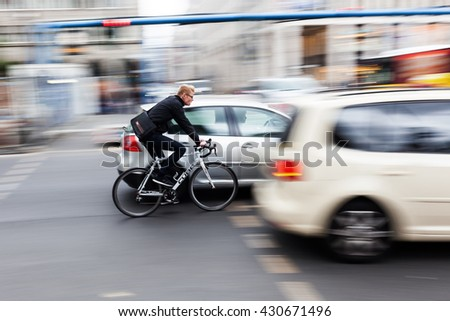 Berlin, Germany - May 17, 2016: unidentified cyclist in Berlin traffic. Berlin is the capital of Germany and with about 3.5 mio inhabitants and a global city of culture, politics, media and sciences - stock photo