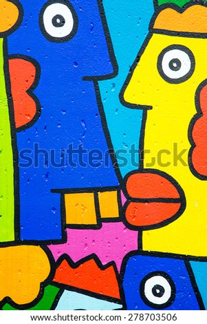 BERLIN GERMANY NOV 18: Colourful cartoon style graffiti on the streets of Berlin. Urban street art is very popular within the city. In Berlin on November 18th 2013 - stock photo